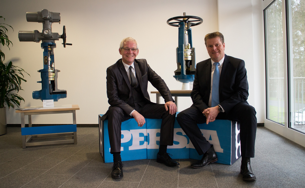 Managing Director KlausWesterwell and Head of International Sales and Marketing NorbertClasen in front of the 'stop-check valve' model